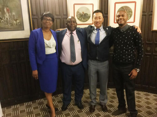 Nichotan staff poses with Ziping Feng of Thompson Rivers University at Meikles Hotel Zimbabwe